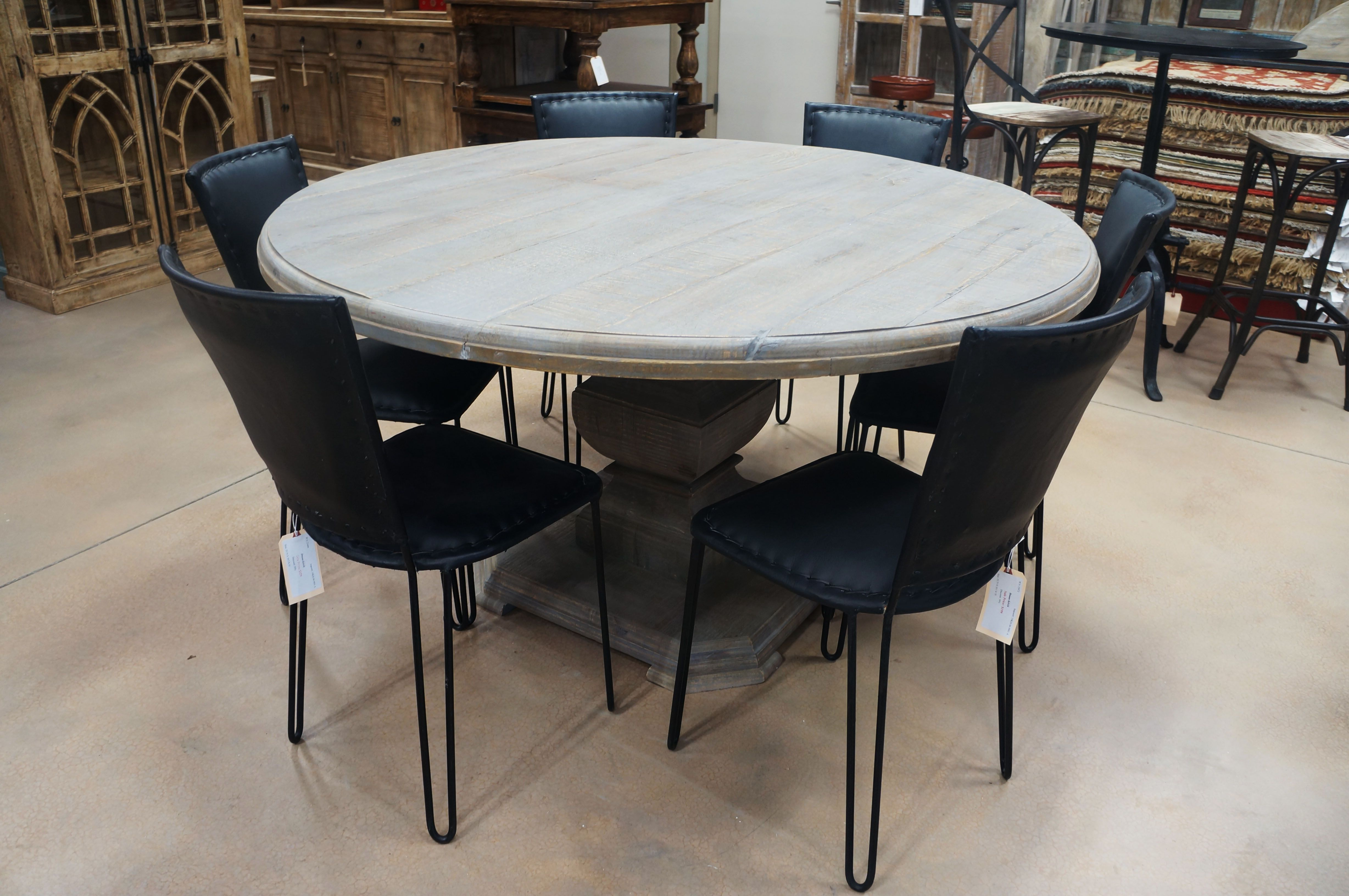 Round Dining Table With A Grey Finish 60 Inches Round With Couple Of Black Leather Chairs Around It Round Dining Table Dining Table Black Leather Chair