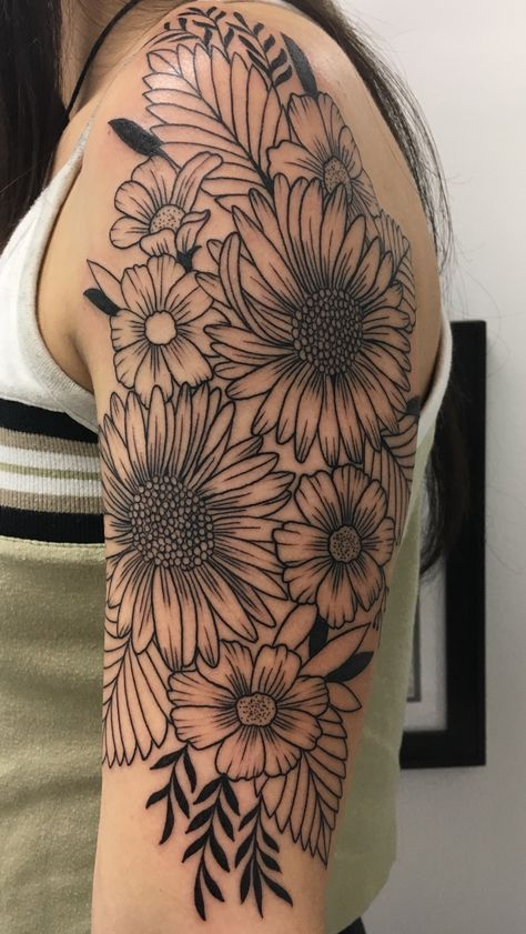 number 4: half sleeve wildflower tattoo , took about 3 1/2 hours