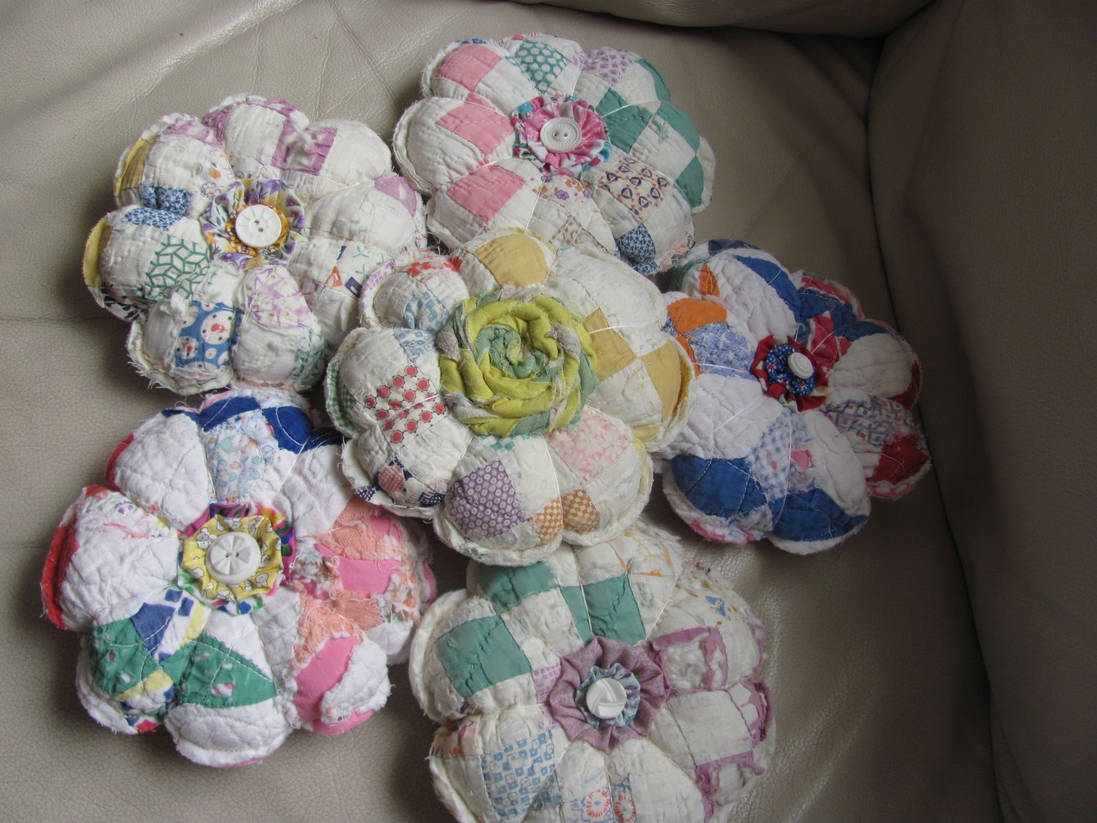 pincushions created by me from vintage cutter quilts.