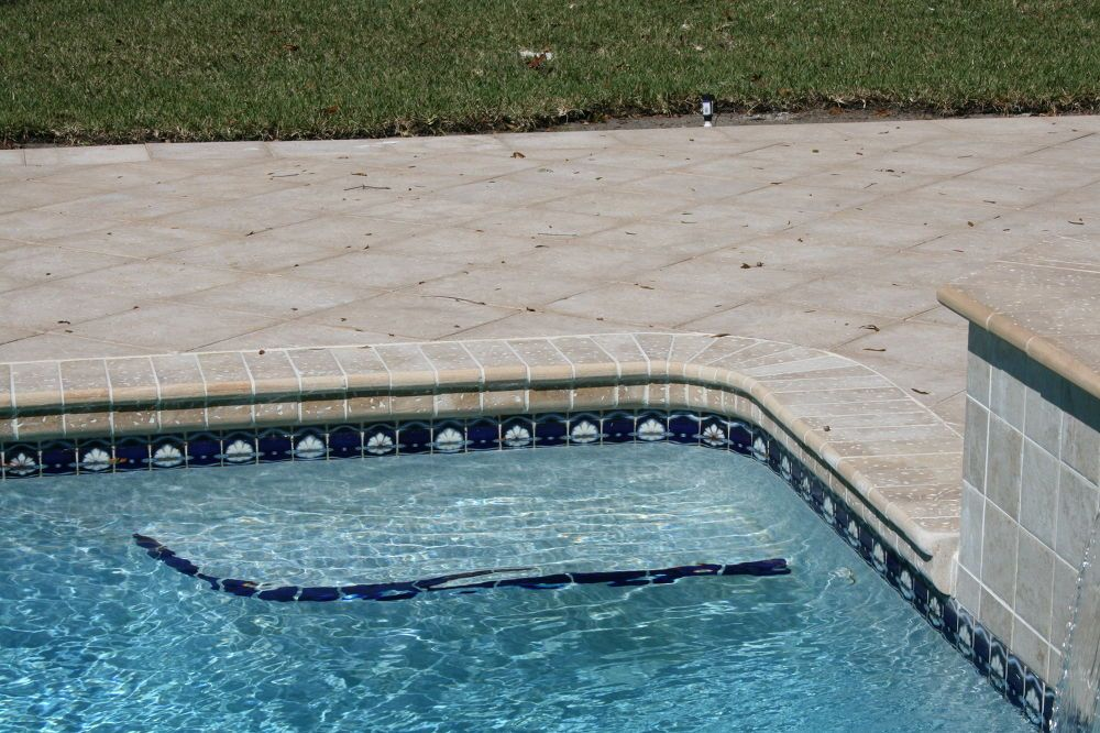 Renovating A Pool Deck Without Removing Old Cracked Concrete Deck Pool Pavers Concrete Deck Pool Landscaping