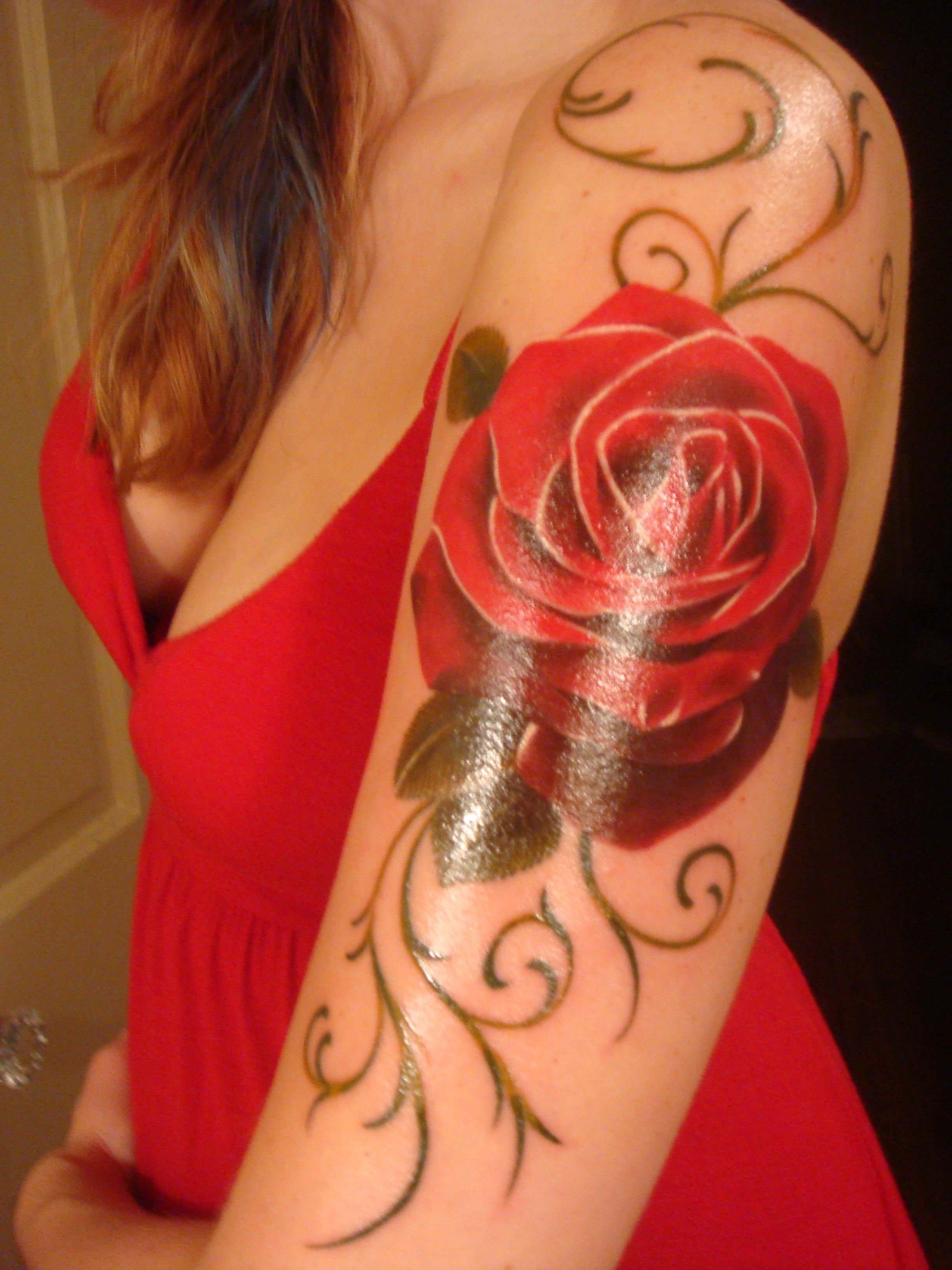 "This tattoo is in memory of my mom...""In a rose tattoo, in"
