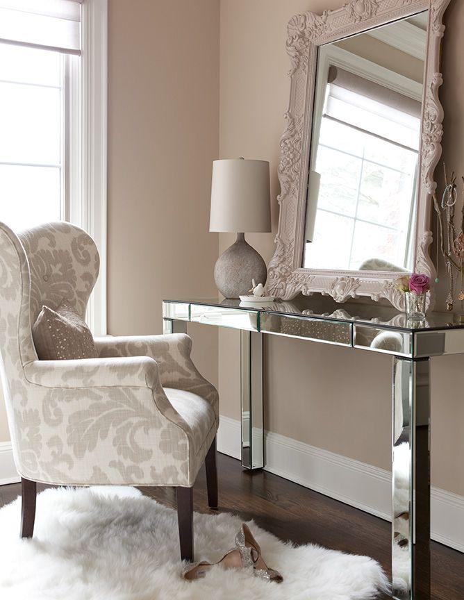 The Elegant Abode LI Bedroom. Mirrored vanity, wing chair, fur rug ...
