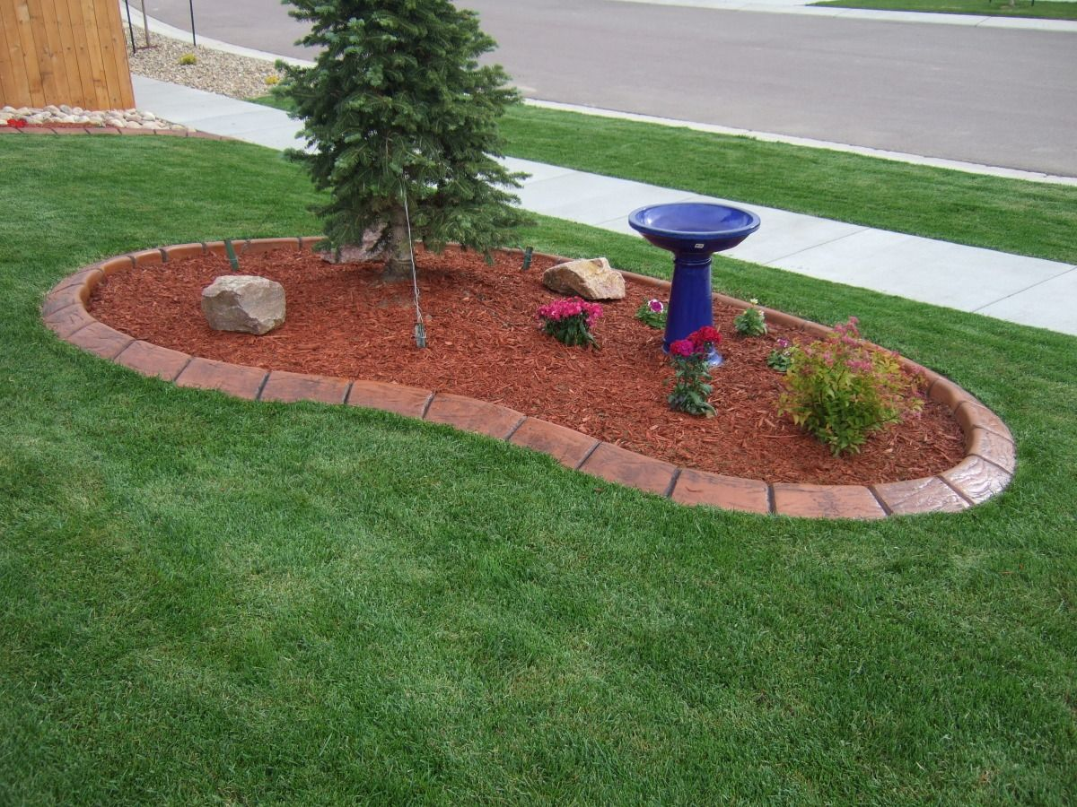 Landscape Island made of stamped concrete by A Better Edge. Holds back the  mulch and
