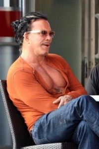 """Mickey Rourke """"Does this shirt make my cleavage pop?"""" SurferWife's Fashion Disasters"""