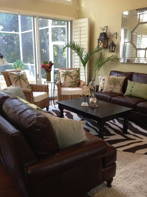 So classic Love the brown leather sofa the printed throw pillows