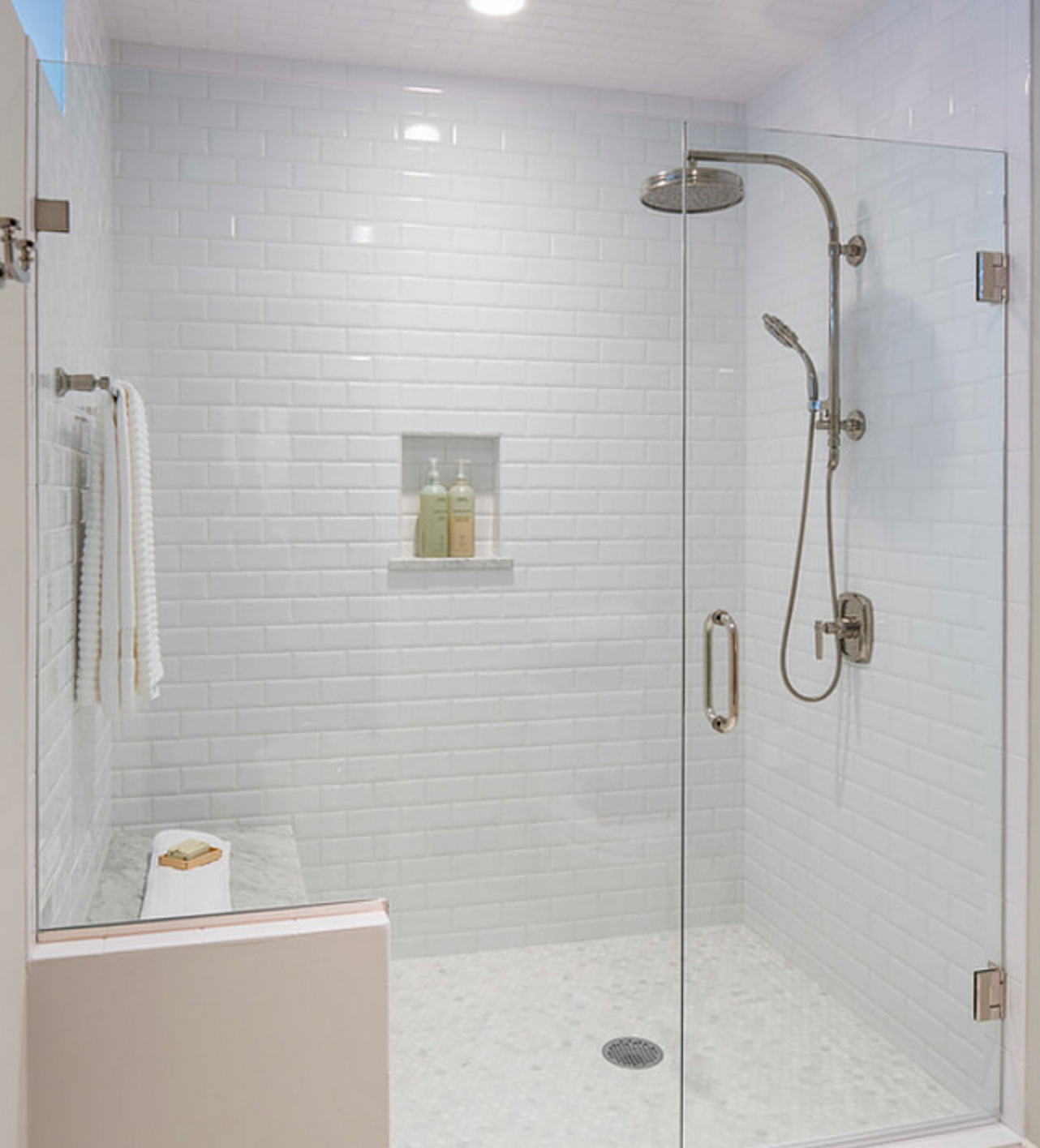 3x6 White Glossy Subway Tiles With 2x2 Carrera Porcelain Tiles On