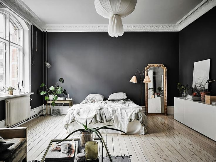 This Small Dark Walled Studio Apartment Is Proof That Rules Are Made To Be Broken