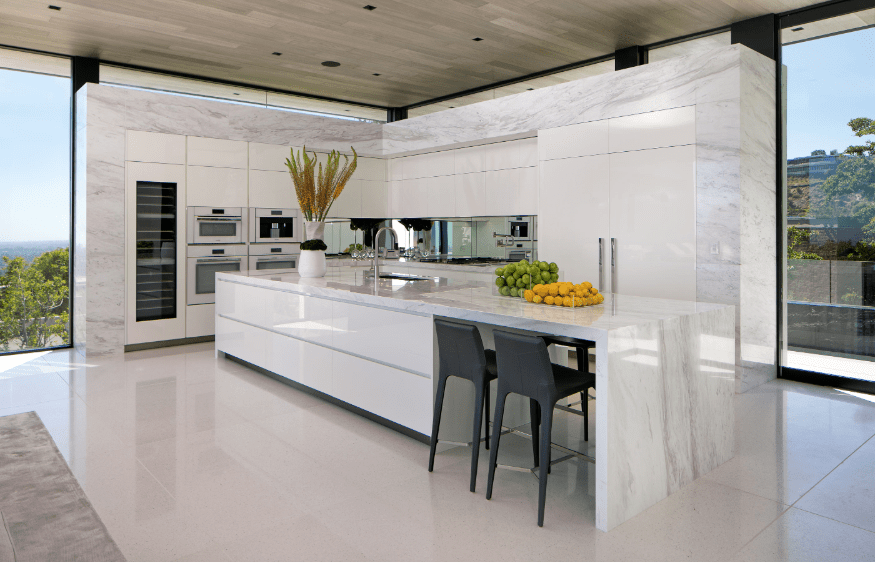 modern marble l shaped luxury kitchen with long island two double wall ovens all flanked by on l kitchen id=97681