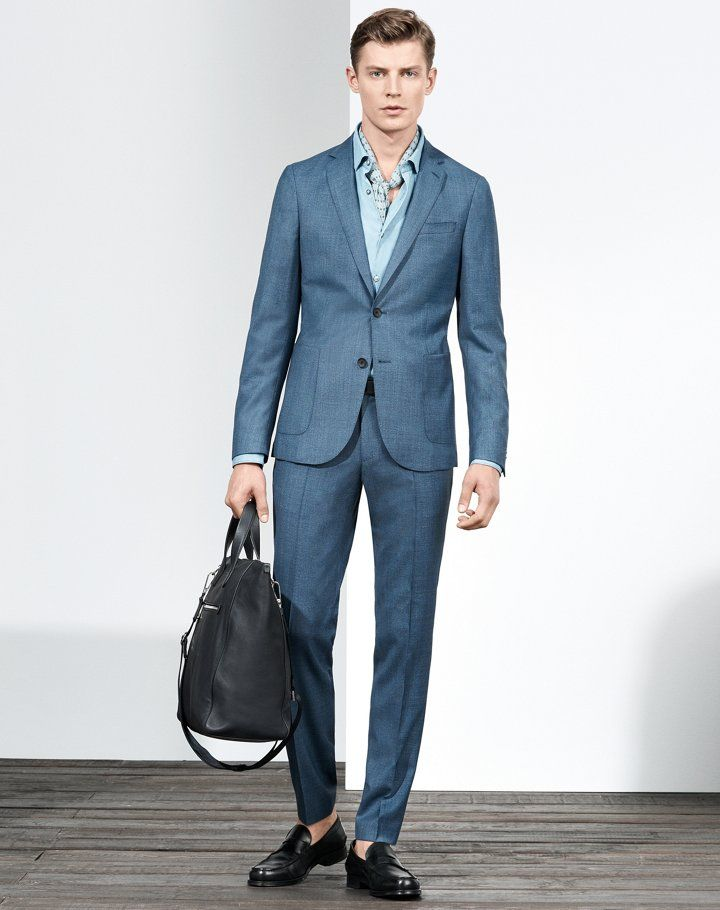Man is wearing a  BOSS suit with a BOSS bag and shoes