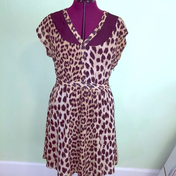 Cheetah print and lace dress Very cute and great quality. Pin up dress with black lace detail. Size Large. Right above the knee length Forever 21 Dresses
