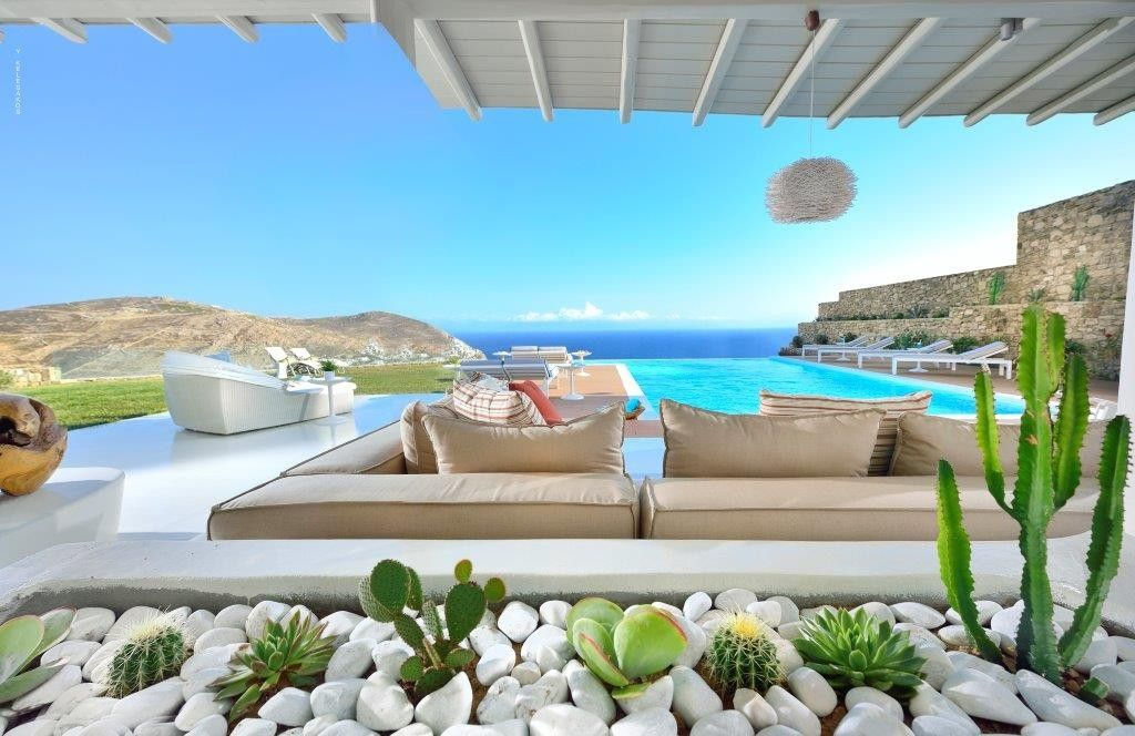 Located on a calm elevated plot, overlooking the serene shores of Elia, this newly built Mykonian gem is a true head-turner from every aspect.  Smartly and elegantly positioned into the island's raw landscape, this villa captures the essence of true Mykonian living....