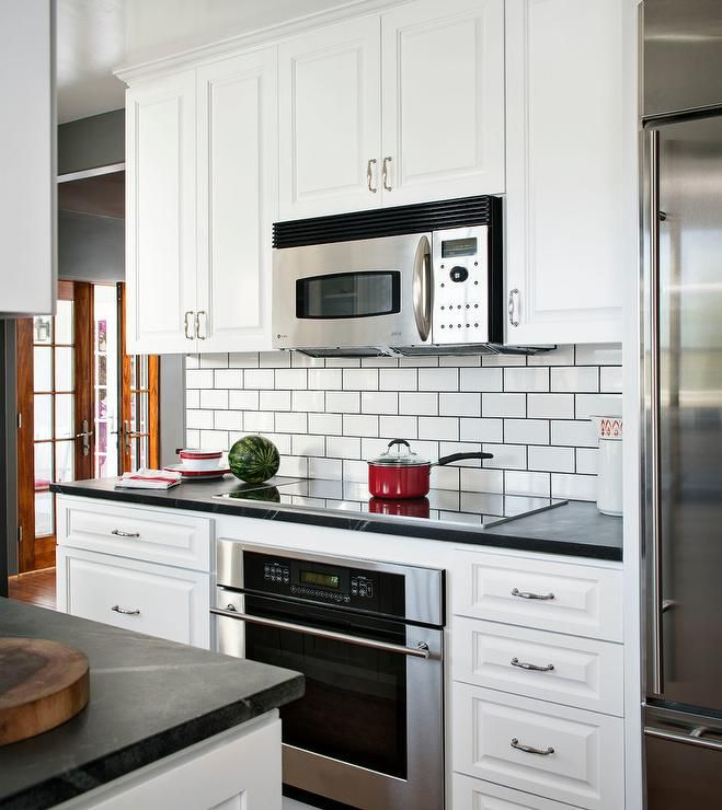Two Toned Black And White Kitchen Features An Induction