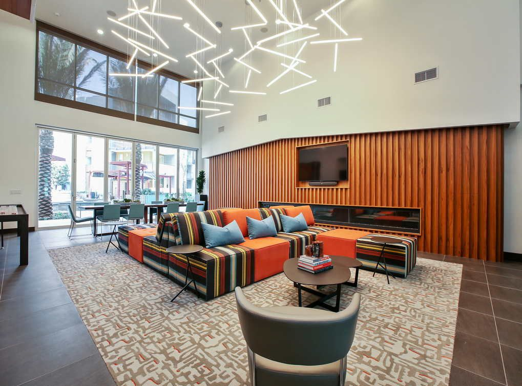 The Lobby Is Stylishly Done Up In Orange Tones Under A Collection Of Stunning Lights Looking For Apartments Apartment Home