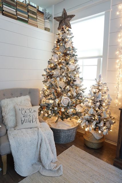 such a lovely farmhouse christmas tree filled with white decorations the stand and the topper perfection a farmhouse christmas home tour
