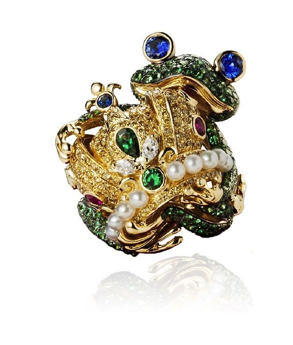 gold frog set with diamonds sapphires and garnets clutching a pearl