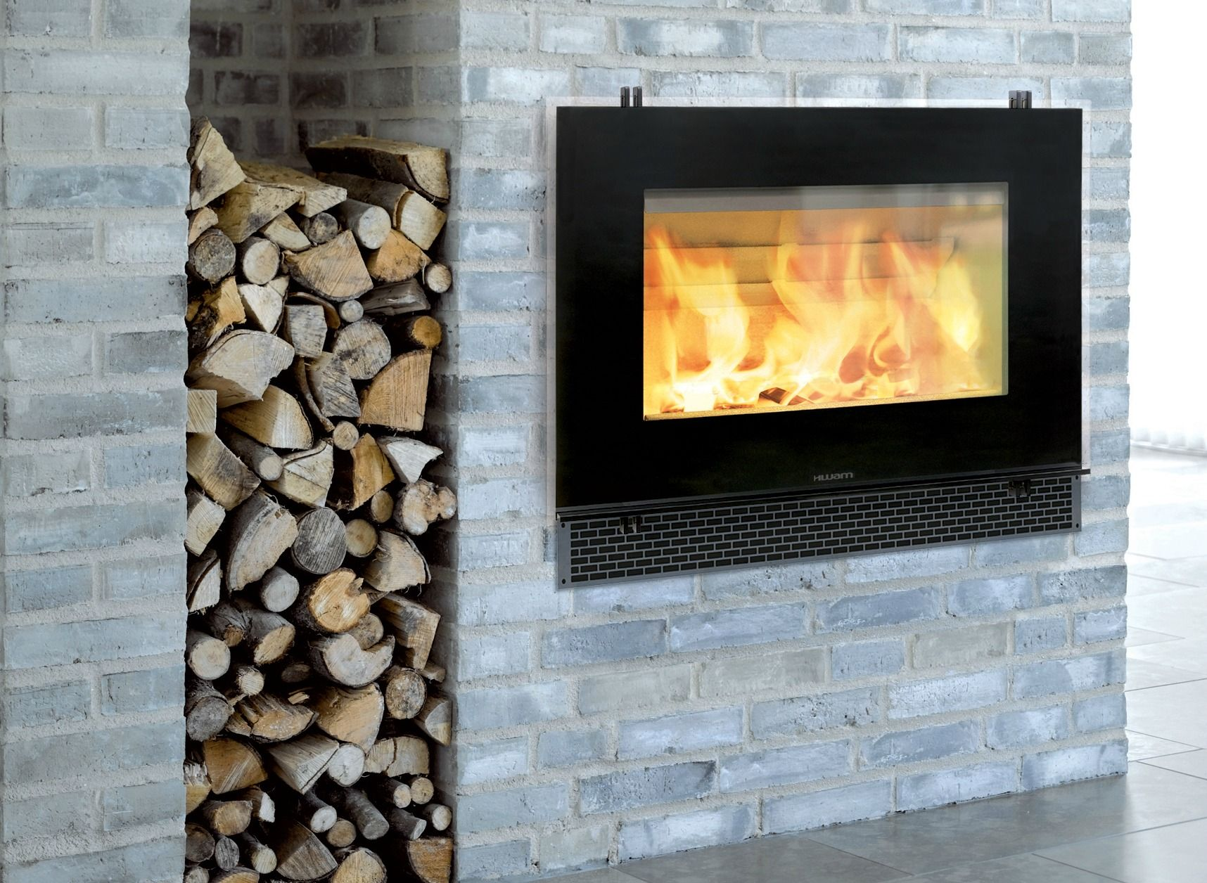 Grey brick and Fireplace des…