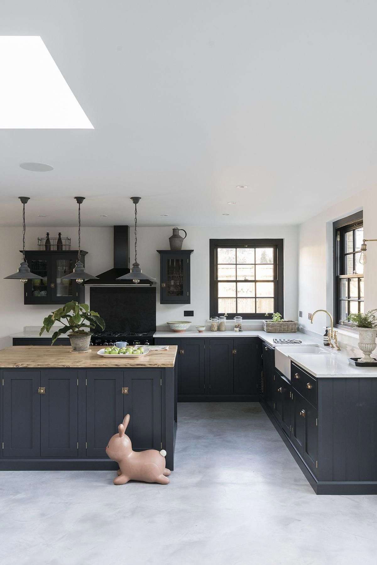 Modern Classic navy painted kitchen designed by DeVol