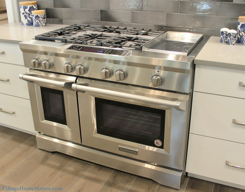 Painted white cabinetry and KitchenAid appliances including ...