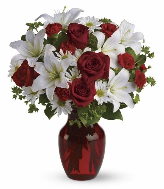 A Ruby Red Glass Vase Displays A Beautiful Bouquet Of Red Roses Carnations And White Lilies Fresh Flowers Arrangements Fresh Flower Market Red Roses