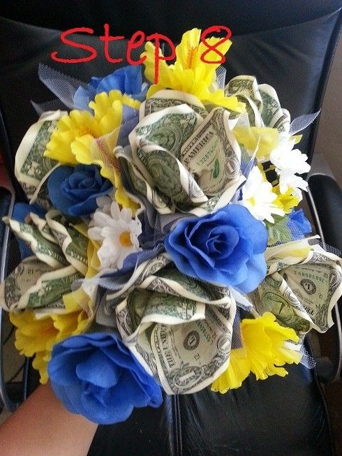 Step 8: Start adding the money flowers to your bouquet by twisting ...