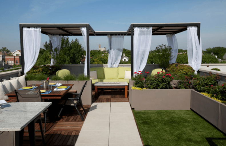 The city view this backyard is short on space but the designer utilized every square foot by adding retaining walls patio sets for outdoor eating