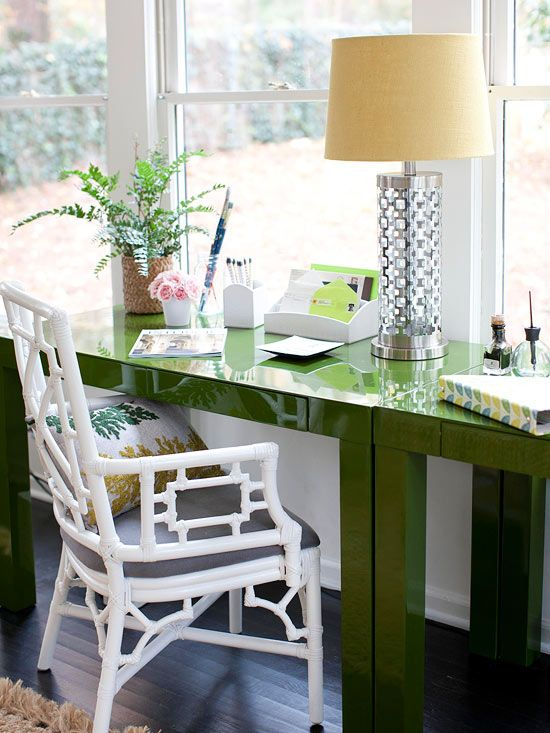 A vibrant green desk adds a pop of color to this office.