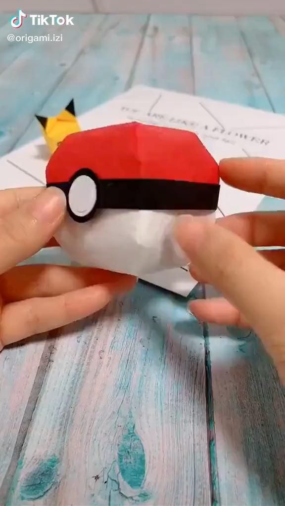 Photo of Origami. Pikachu. And ball.