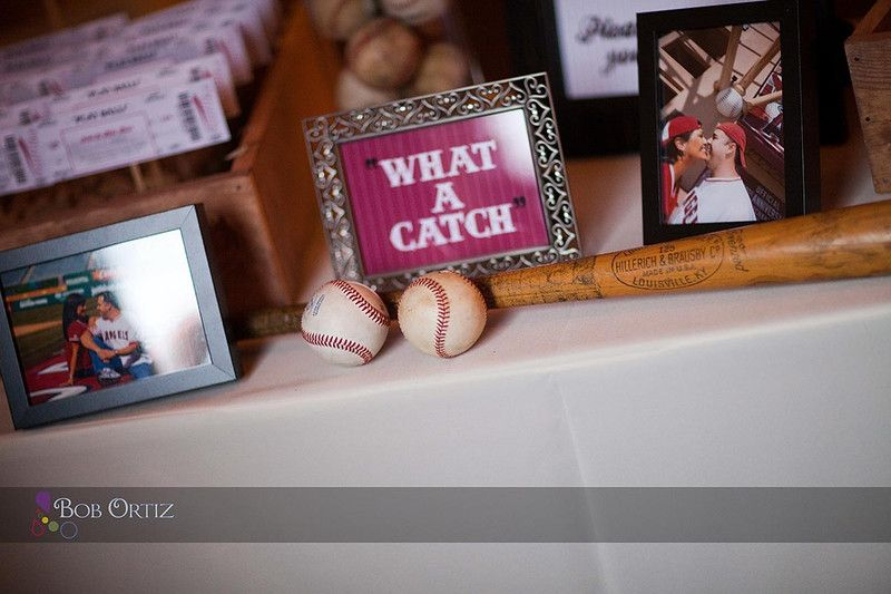'What a catch' sign accompanied by baseballs and/or a baseball bat for the guests to sign!