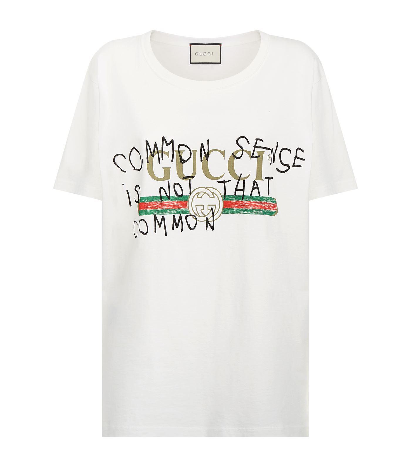 d19d2a9c082 Gucci Slogan Logo Print T-Shirt
