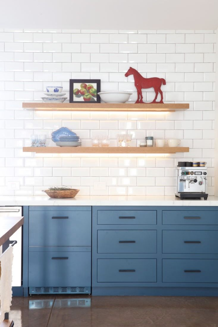Modern farmhouse. Remodelista kitchen. Blue cabinets. Black hardware ...