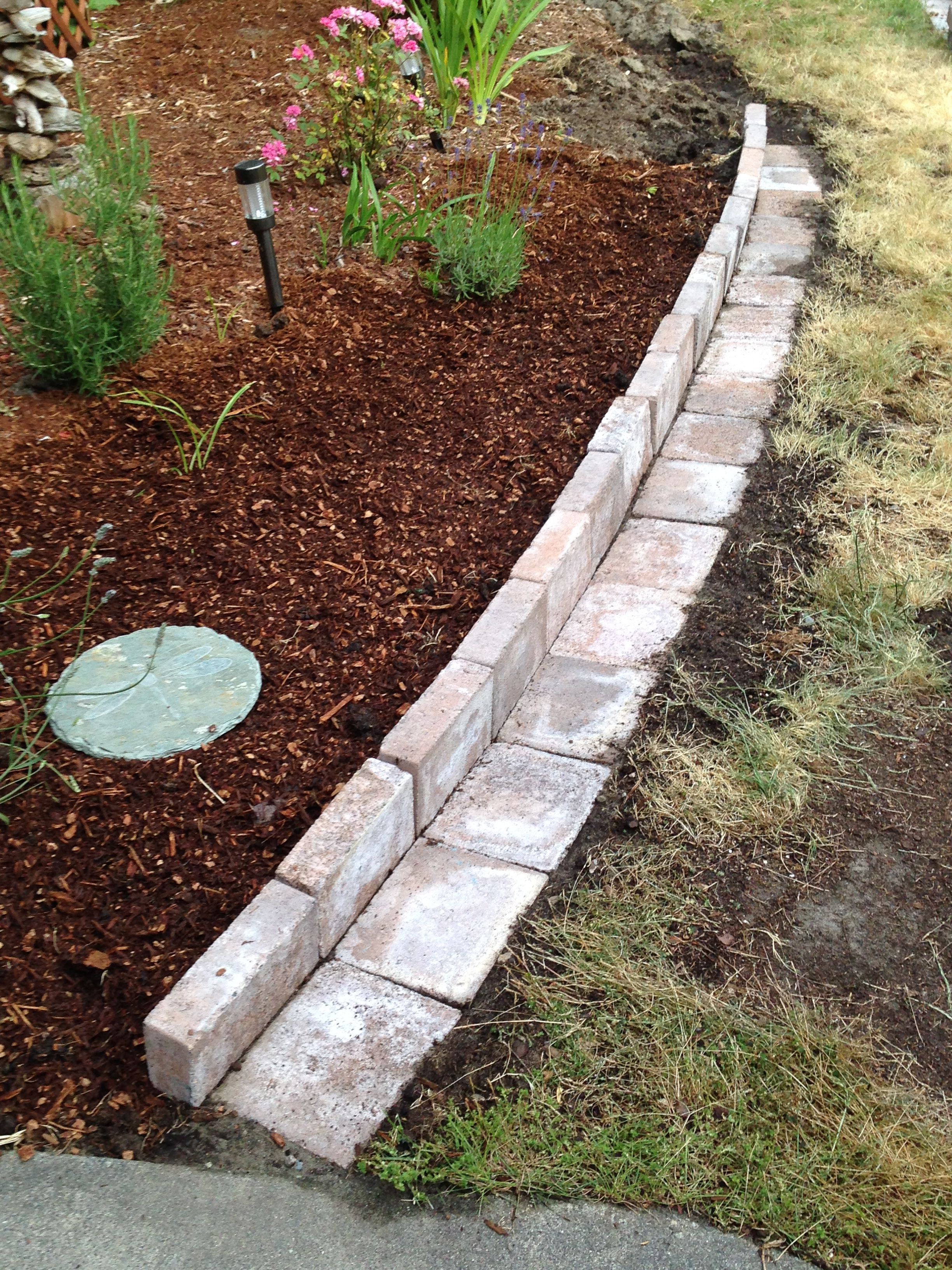 New flower bed border made with pavers.....this style