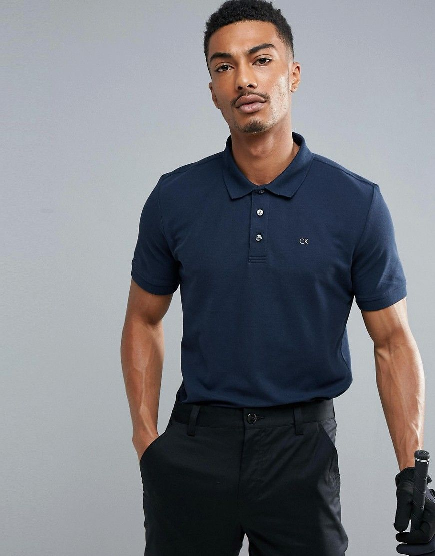 2b216395 Get this Calvin Klein Golf's polo shirt now! Click for more details.  Worldwide shipping. Calvin Klein Golf Polo - Navy: Polo shirt by Calvin  Klein Golf, ...
