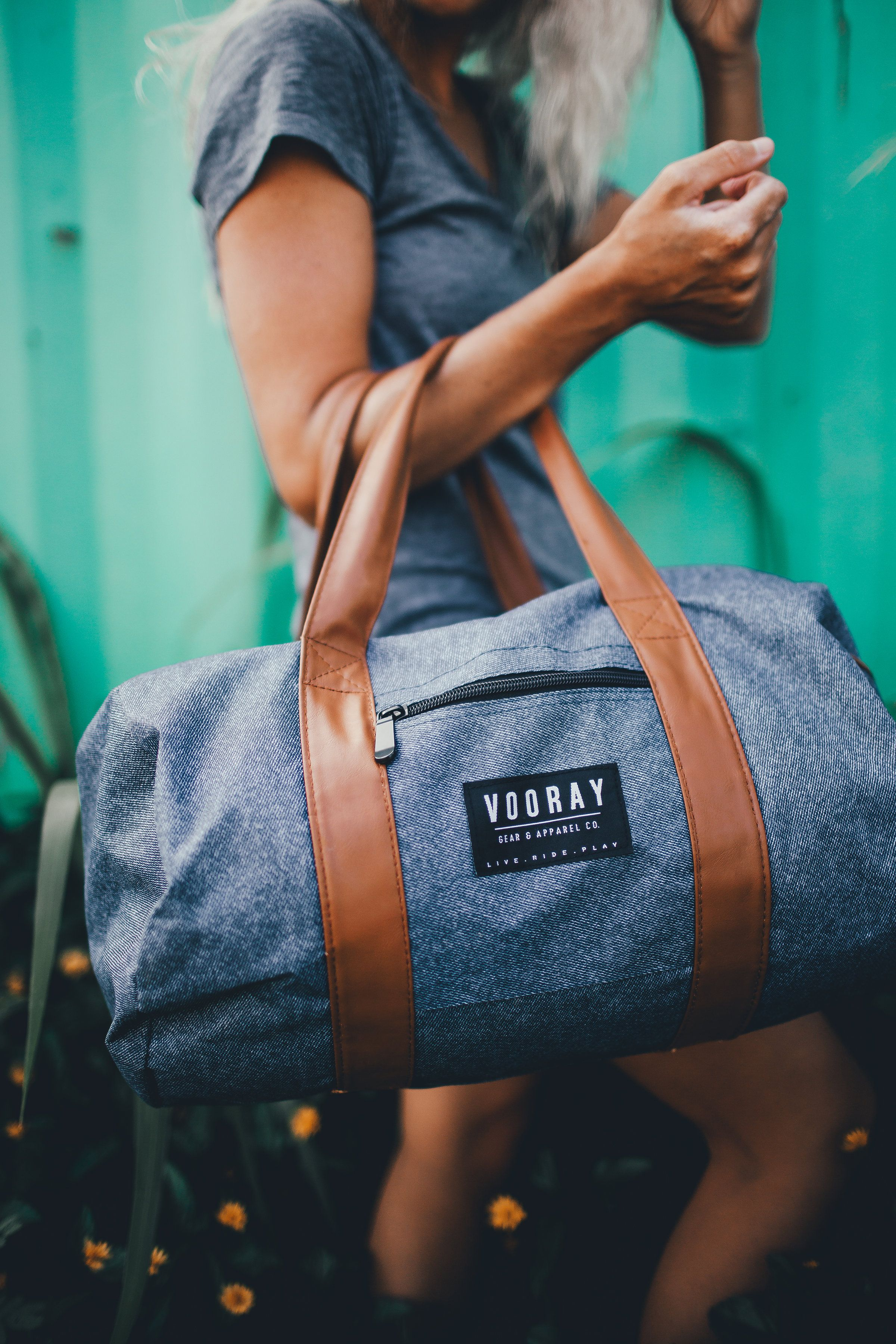 342bf06c9d46 Fitness on the go starts here. The Roadie Gym Duffel shown in Heather Blue.  Buy your new favorite gym bag today at Vooray for only  29.99.