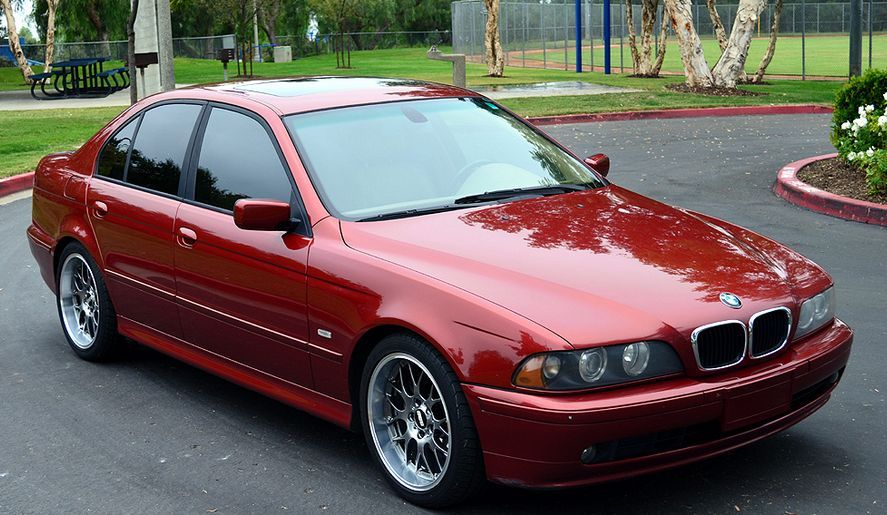 BMW E39 M5 red with shadow line trim