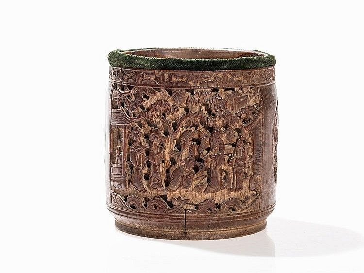 Bamboo China, 19th century Cylindrical shape on a circular base rim Revolving carving with figures in rectangular reserves and phoenixes in round medallions Depicted in relief are scholars with their students under trees, flanked by pavilions The upper edge with an all-round floral border The mouth is accentuated by velvet (later) Height: 12.5 cm