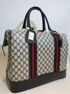 gucci vintage. vintage gucci luggage bag from 70´s with gg logo in navy.