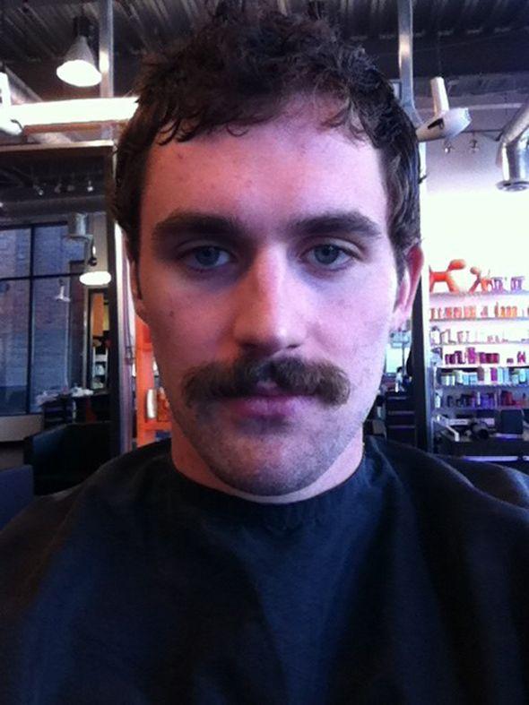http://blogimages.thescore.com/tbj/files/2012/04/kevin-love-mustache.jpg