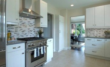 Another white kitchen I likes. Modern, but comfortable.