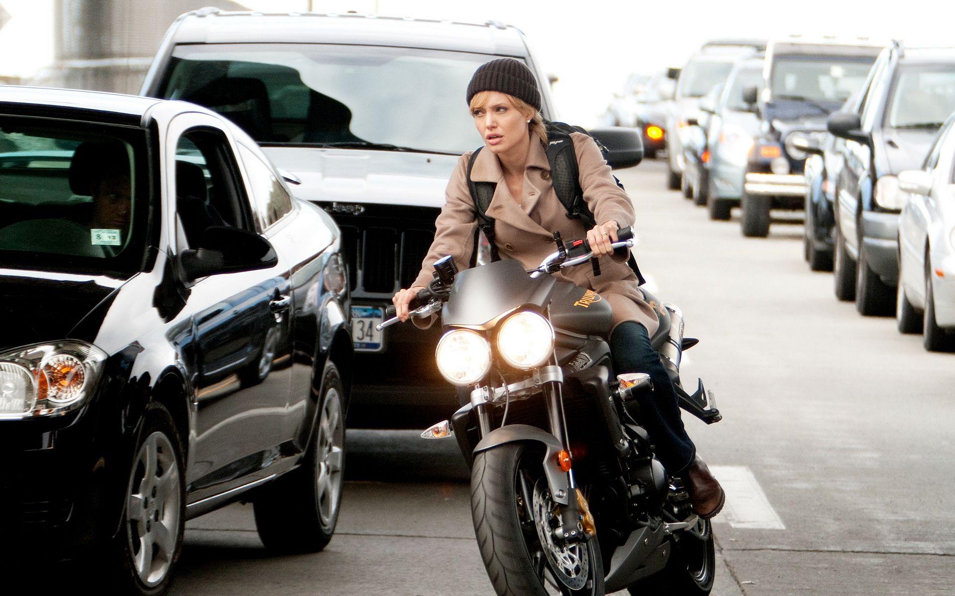 angelina jolie on a 2009 triumph street triple r motorcycle in the movie salt