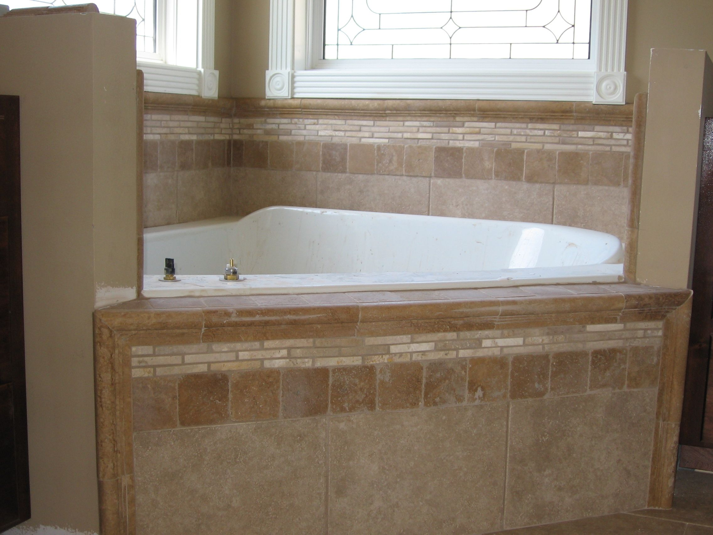 soakertub backsplash | Custom tile work on a master garden tub in ...