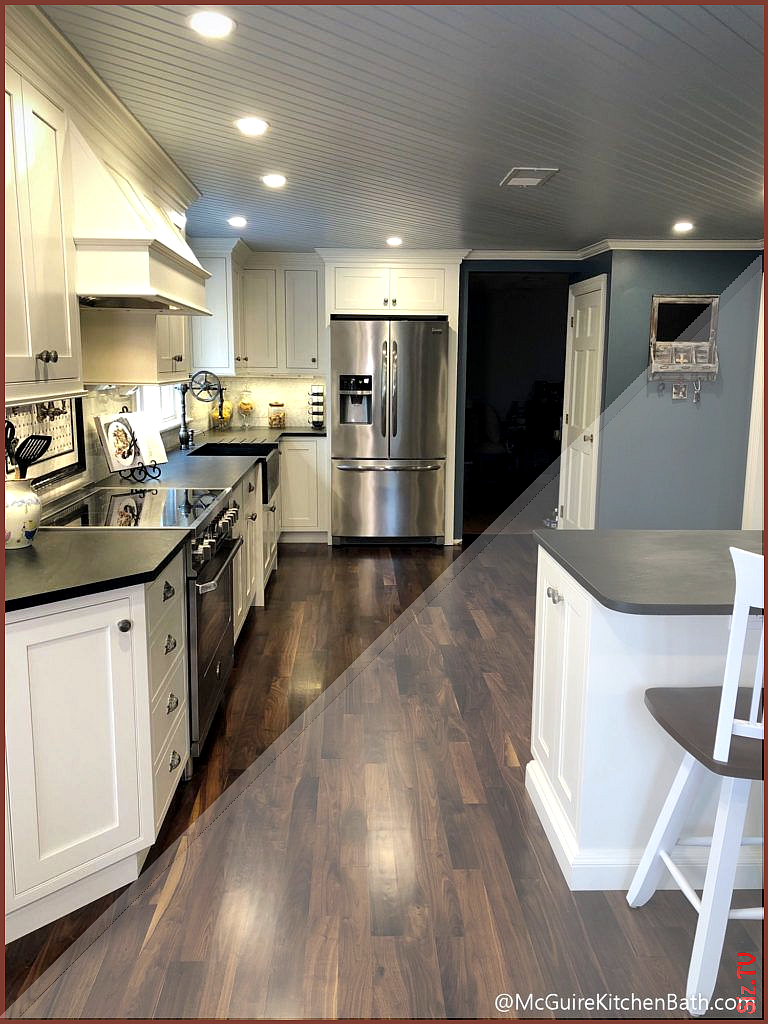 Modern farmhouse kitchen with blue beadboard ceiling