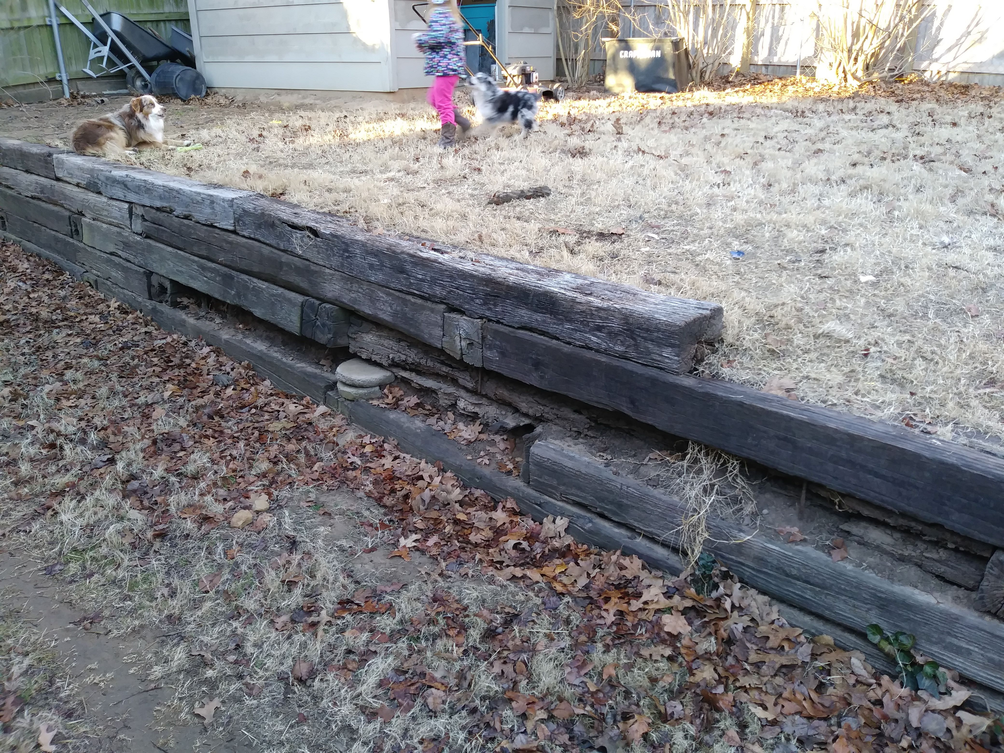 Does Anyone Have Suggestions For Repairing A Wood Retaining Wall It S Made From Railroad Wood Retaining Wall Retaining Wall Repair Railroad Tie Retaining Wall