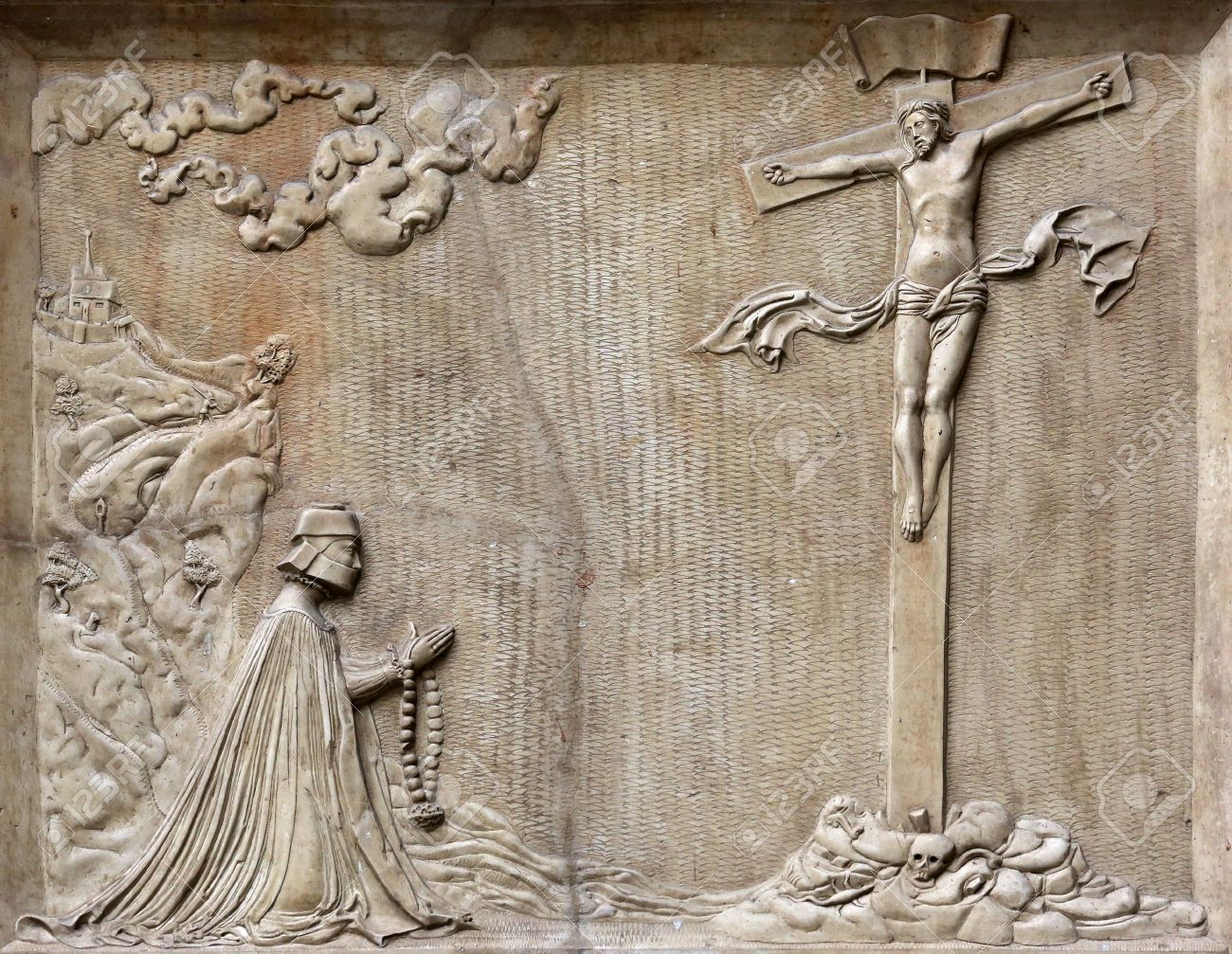 An old crucifixion relief sculpture outside st