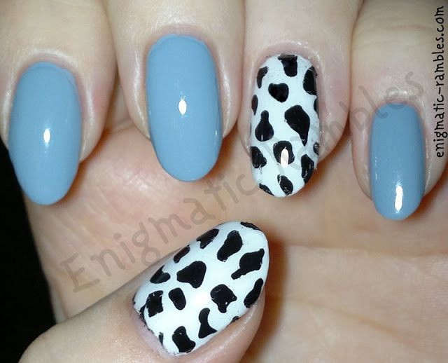 Photo of Cow Print Accent Nails
