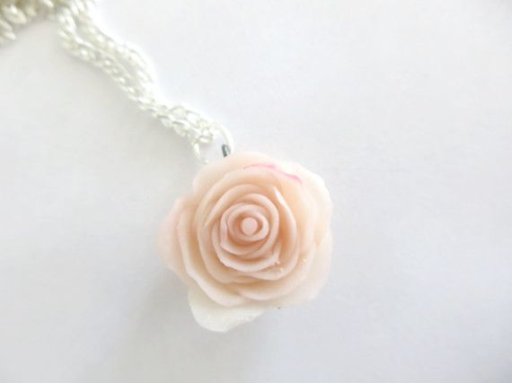 This listing is for one pink rose clay necklace accompanied by a 22 inch silver chain. Very simplistic and ...