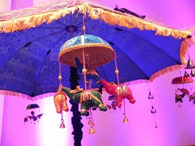THIS IS EXACTLY WHAT I WAS TALKING ABOUT, THE COLOURFUL BRIGHT LAVISHING UMBRELLA'S!