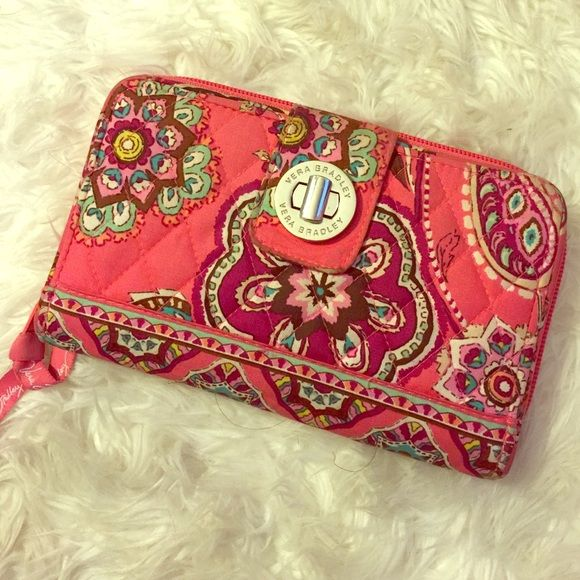 Vera Bradley Wallet Gently used. Has wear on the opening where the buckle is. Vera Bradley Other