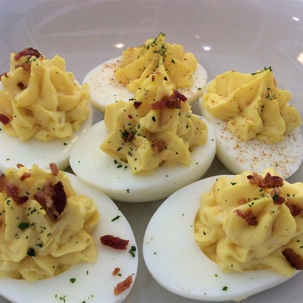 "Bacon Cheddar Deviled Eggs | ""I've made this recipe several times for different functions and they all request it over & over. These eggs are truly eggs-trodinary! Totally different from your normal deviled eggs!"""