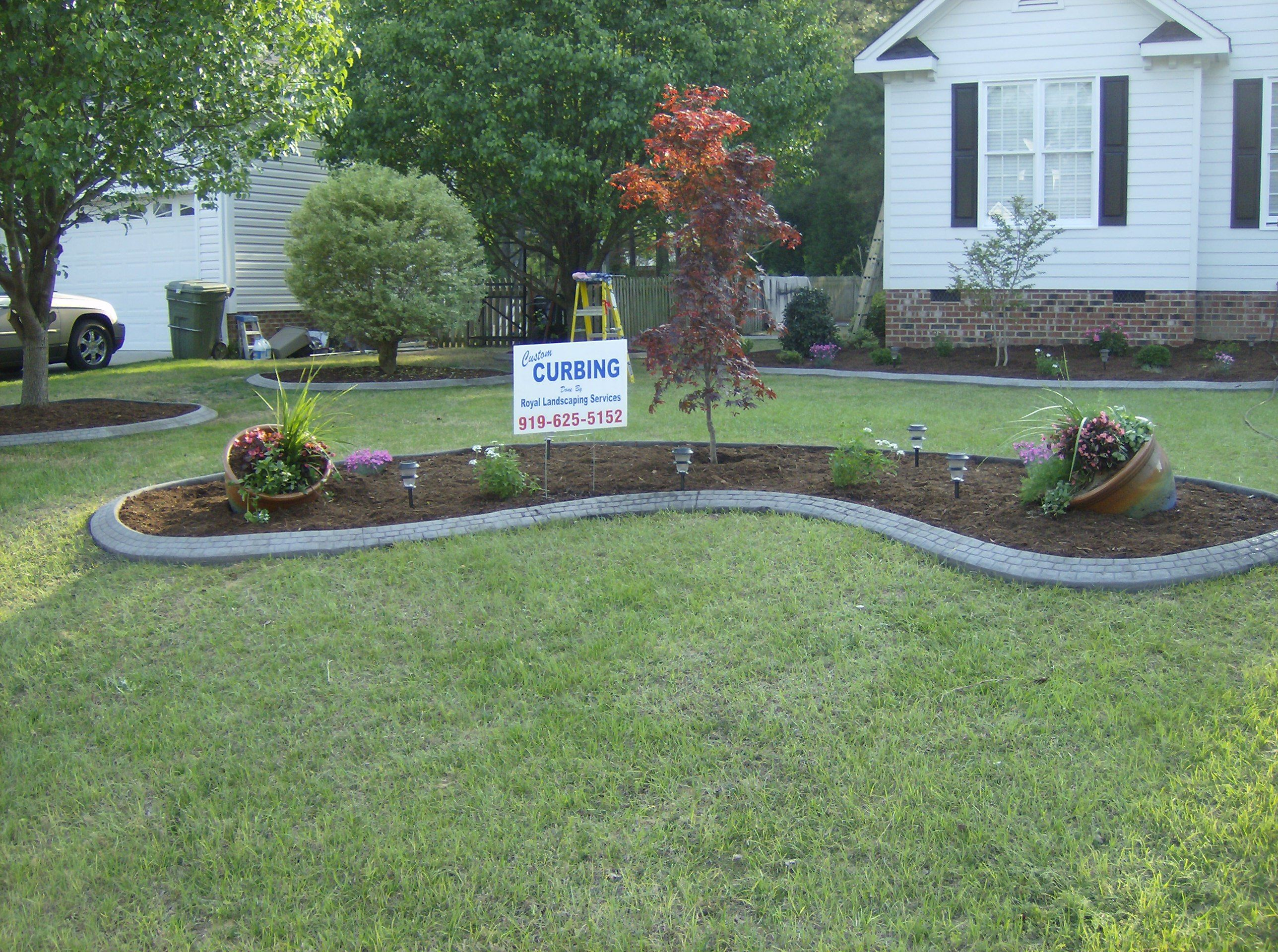 Flowerbed borders royal landscaping services and curbing for Edging flower beds with edger