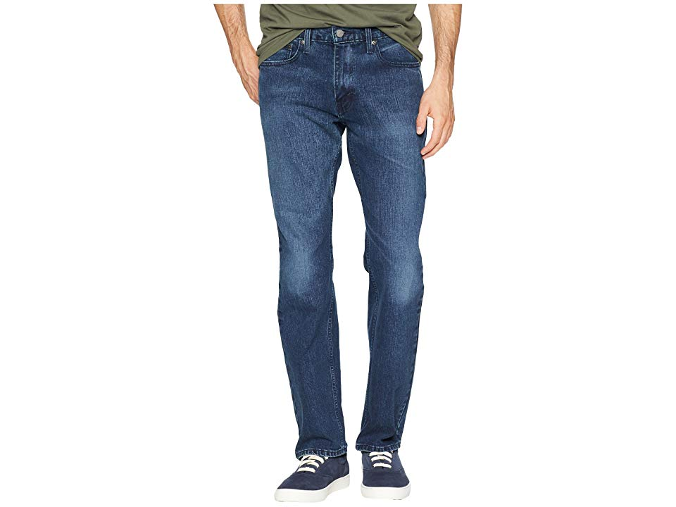 Levi's(r) Mens 559tm Relaxed Straight (Ink Jet/Stretch) Men's Jeans. A modern take on the uncompromising Levi's classic. The 559 cut features an easy fit through the seat and thigh that's relaxed without being too loose. Straight cut through the leg for a modern line. Sits below the waist with a slightly higher back for improved coverage. Classic  five-pocket design. Leather brand patch at back waist. Signature arcuate stitch